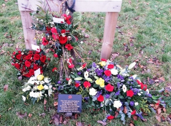 Wreaths  at tree planted by Harry Moses